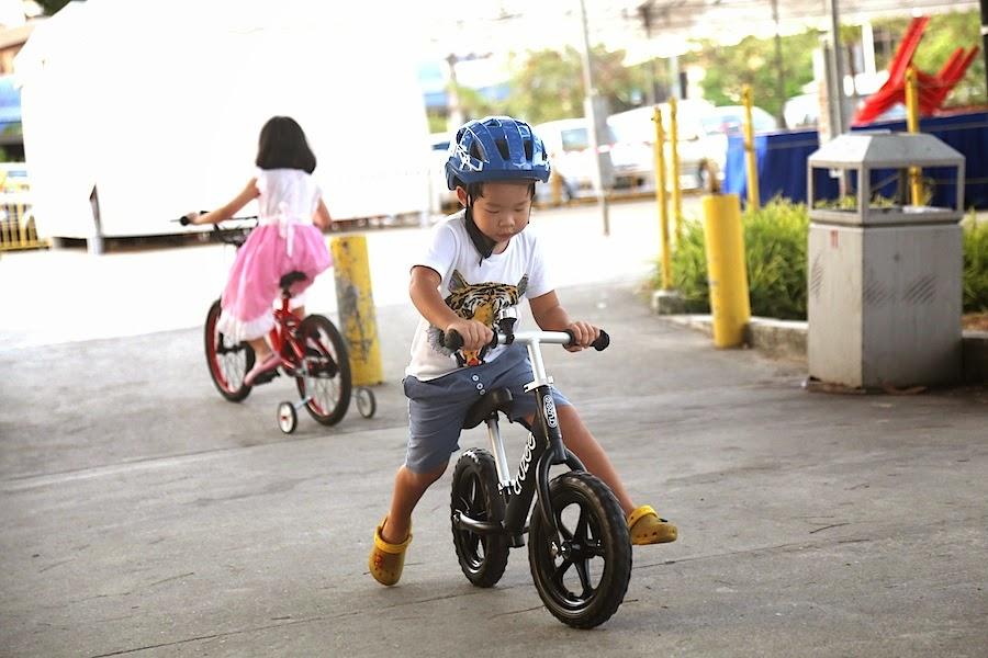 boy is riding a bike