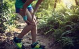 Sports injured knee child in the forest